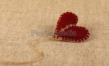 brown felt craft heart over canvas