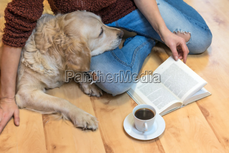 reading book with the dog on