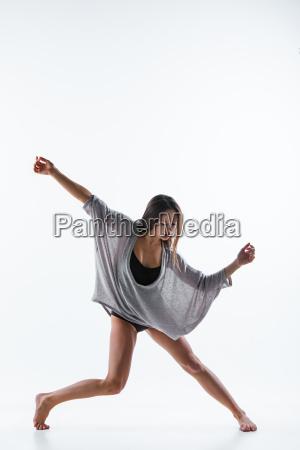 young beautiful dancer in beige dress