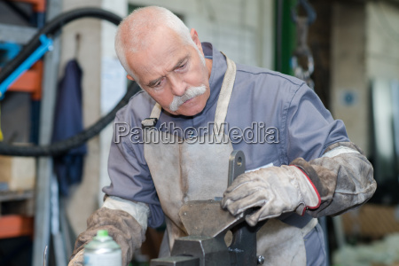 man in ironworks with professional teacher