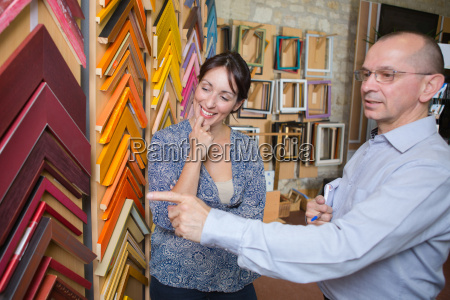 couple looking at frames