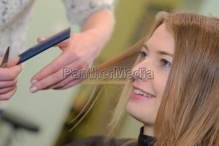 woman haircut at the salon