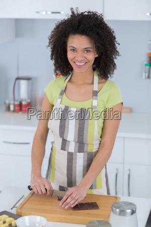 portrait of a black woman cookingchocolate