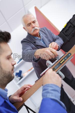 close up carpenter process of wood
