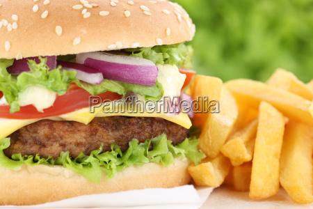 cheeseburger hamburger with french fries closeup