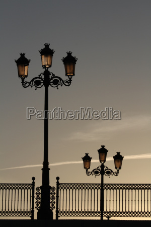 old street lamps and railings on