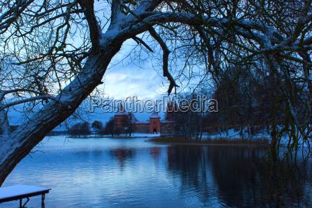 trakai castle in winter on island