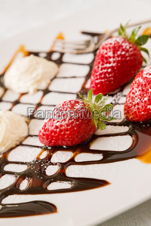 close up of strawberries with whipped