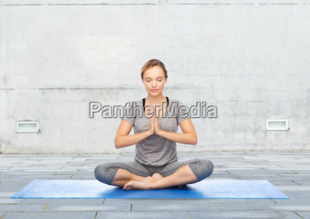 woman making yoga meditation in lotus