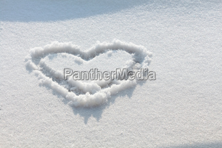 hand drawn heart in the snow