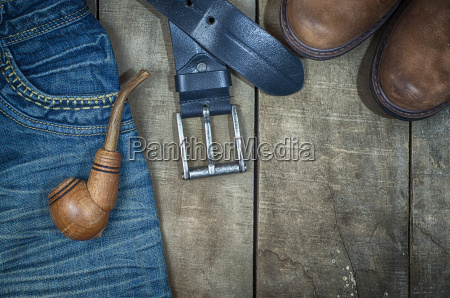detail of worn blue jeans and