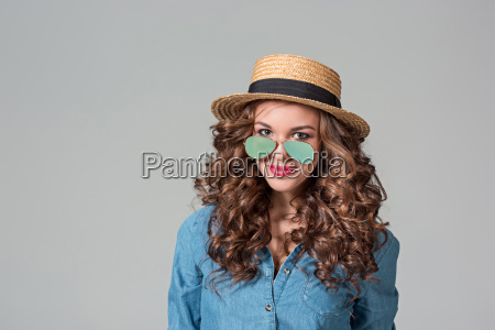 girl in sunglasses and straw