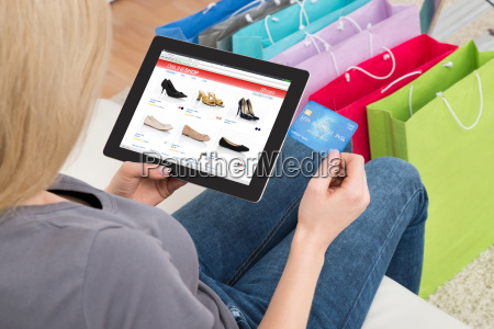 woman shopping online on digital tablet
