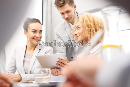 the team discusses business concepts success