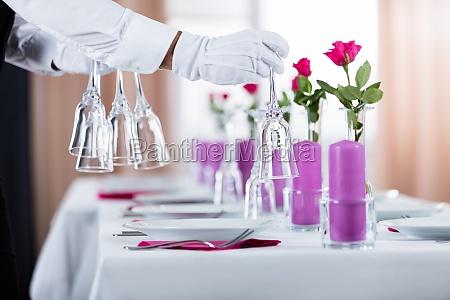 waiter setting wedding table