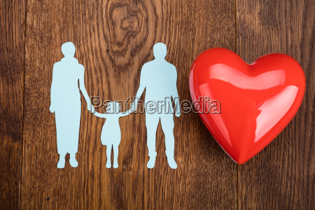 family paper cut with red heart