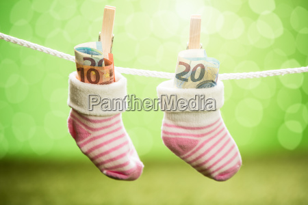 pair of baby sock with dollar