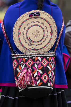 guambiano indigenous woman dressed in colourful