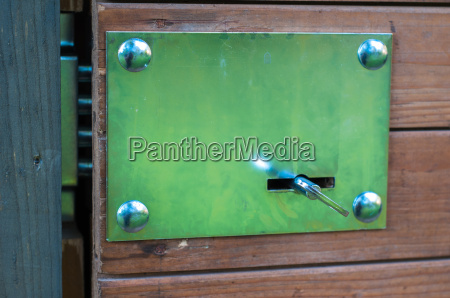 unlocking barn key on old door