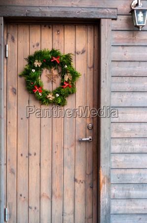 christmas wreath decoration on wooden door