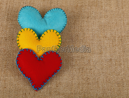 three felt craft hearts yellow red