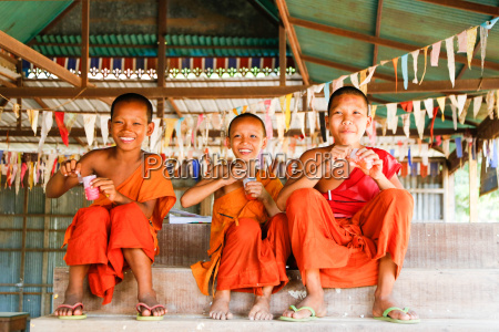 young buddhist monks in cambodia eat