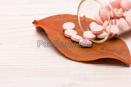 pink pills with orange leaf
