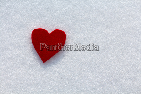 cutout red heart in the snow