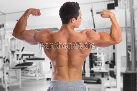 bodybuilder bodybuilding muscles back biceps gym