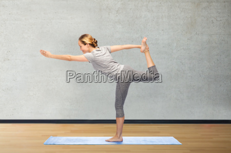 woman making yoga in lord of