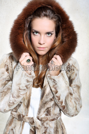unhappy woman in a luxurious fur