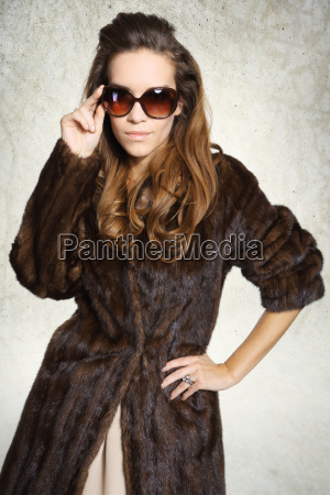 mysterious elegant woman in fur and