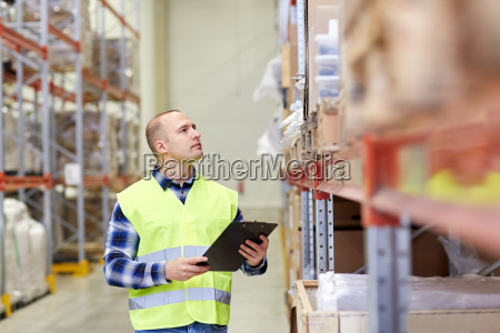 man with clipboard in safety vest