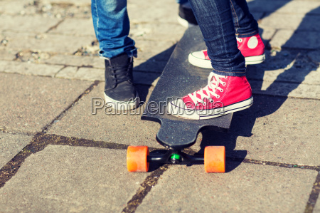 close up of couple with longboard