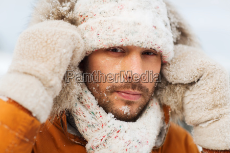 face of man in winter clothes