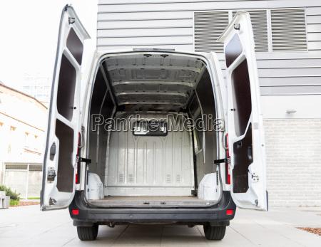 empty minivan car with open doors