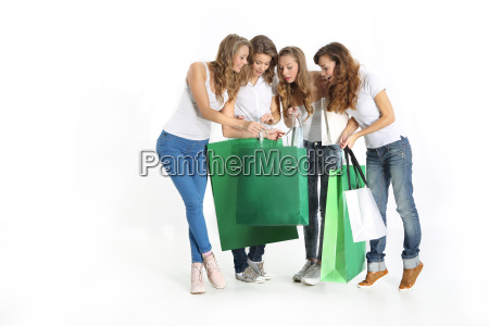 group of beautiful girlfriends shopping together