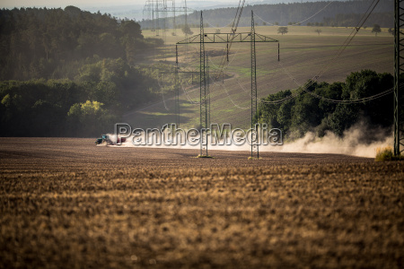 tractor plowing a dry farm field