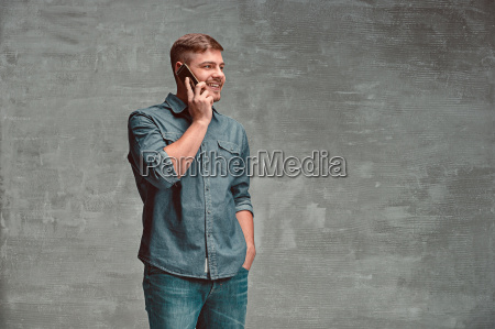 the young smiling caucasian businessman on