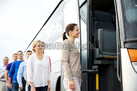 group of happy passengers boarding travel