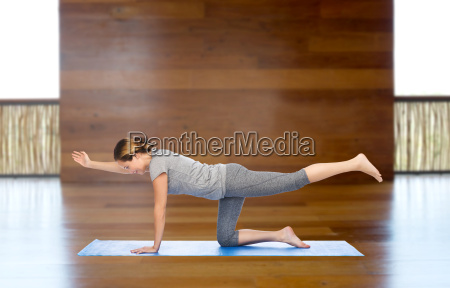 woman making yoga in balancing table