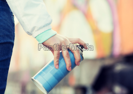 close up of hand holding spray
