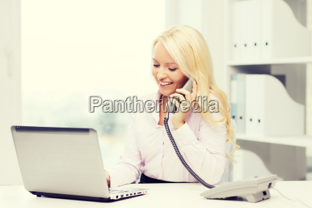 smiling businesswoman or student calling on