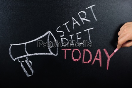 start diet concept written on blackboard