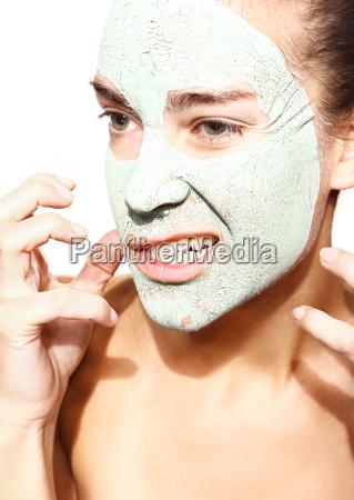 predatory woman in green mask of