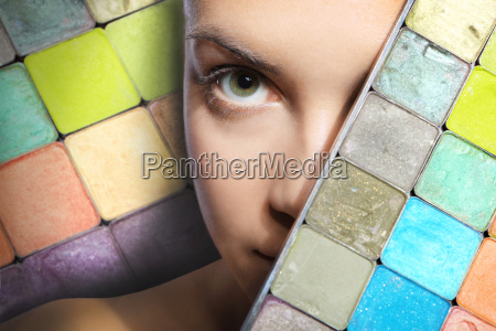 woman and a color eyeshadow palette