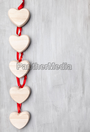 love concept hearts hanging on grey