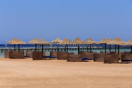beach sun parasol and blue sky