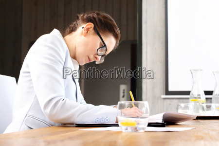 credit advisor signing documents in the