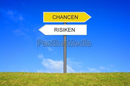 sign signpost shows opportunities and risikio